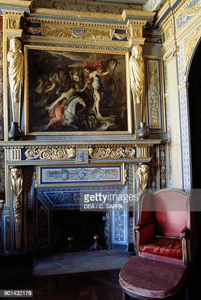 Fireplace and armchair in the Admiral Charles Henri d'Estaing's room Chateau de Ravel Auvergne France 18th century