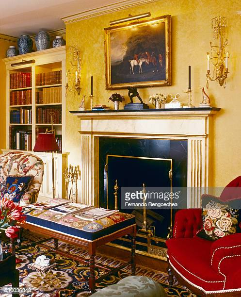 Fireplace and Built-in Bookcase in Living Room with Yellow Walls