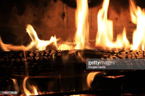 fireplace and fire logs - 暖炉の火 ストックフォトと画像