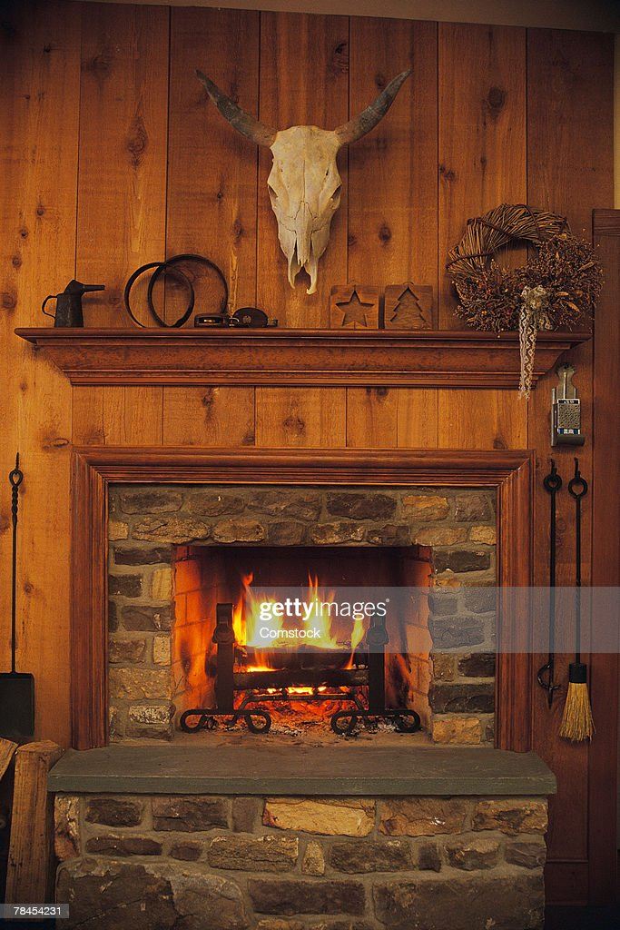 Fireplace and mantle in rustic western lodge : Stock Photo