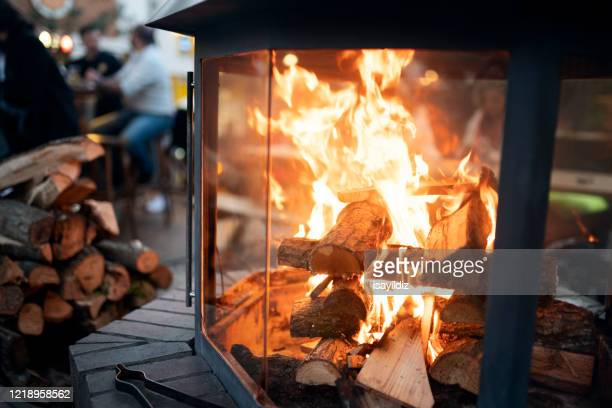 fireplace at the cafe - fireplace stock pictures, royalty-free photos & images