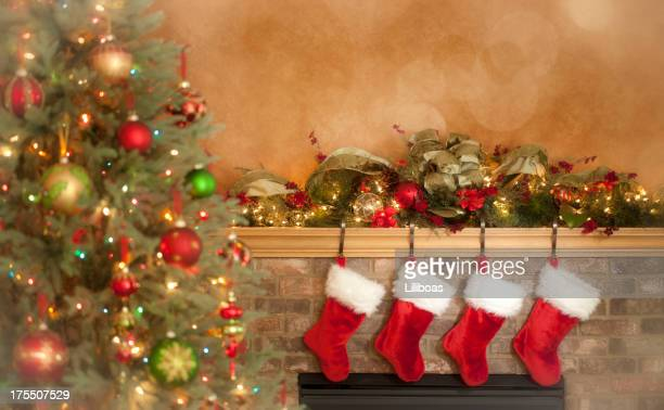 fireplace decorated for christmas on gold - christmas stocking stock photos and pictures