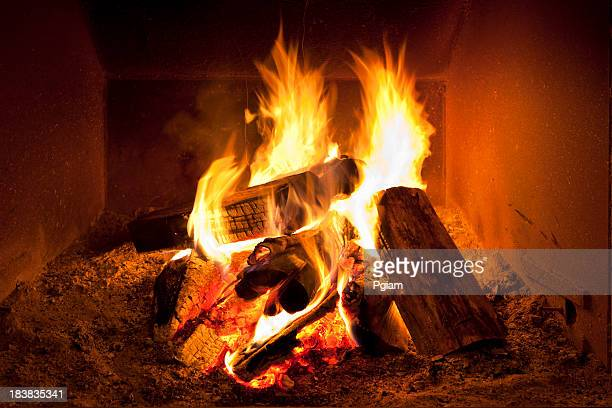 fireplace flames in winter - warming up stock pictures, royalty-free photos & images