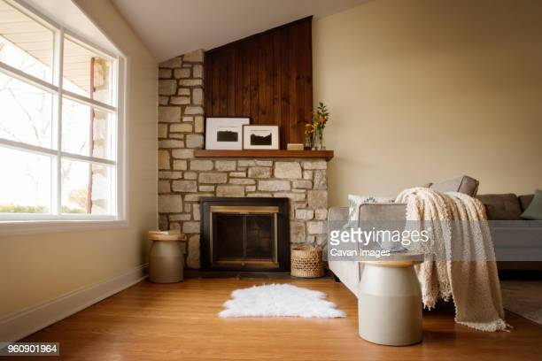 fireplace in living room at home - fireplace stock pictures, royalty-free photos & images