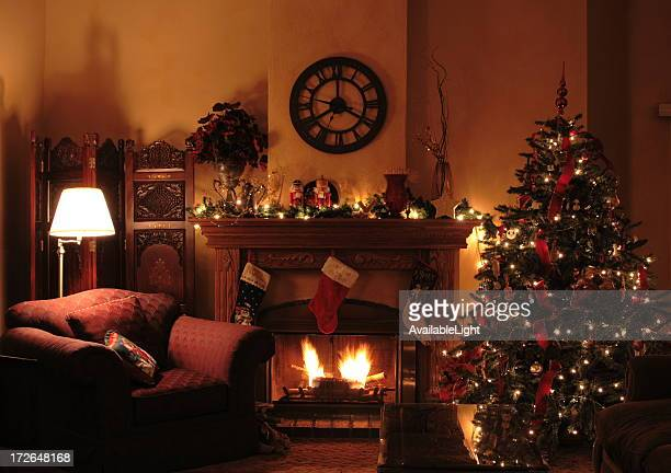 Fireplace scene of dressed up Christmas living room