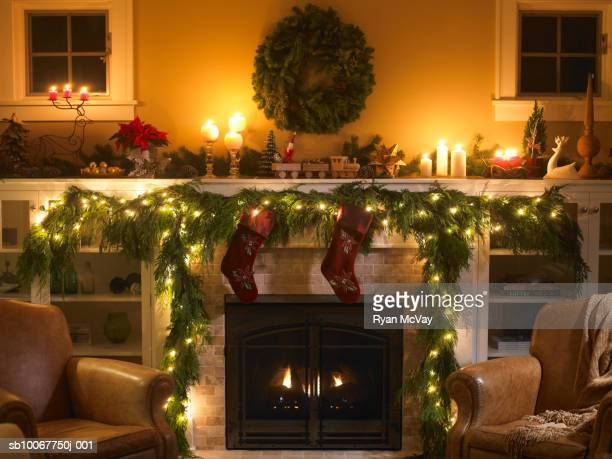 fireplace with christmas decoration - camino foto e immagini stock