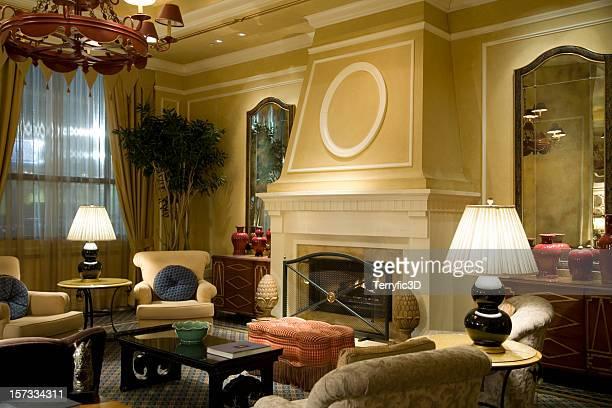 fireplace with comfy chairs in luxury hotel lobby reception - terryfic3d bildbanksfoton och bilder