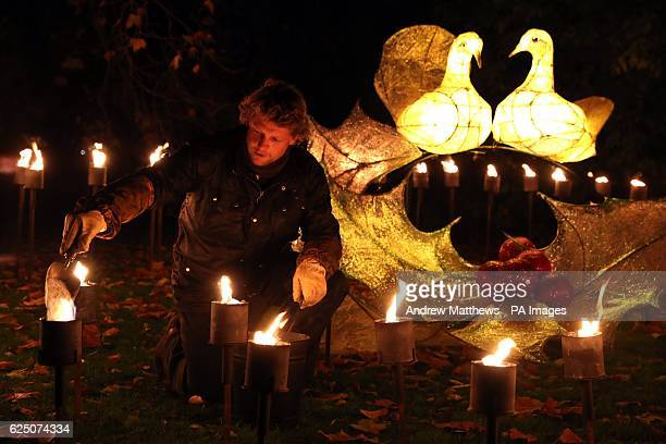 Fires are lit in the Fire Garden which depicts the Five Gold rings from the Twelve Days of Christmas during a preview for Christmas at Kew Gardens...