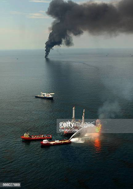 PHOTO––––Fires burn around the site of the BP Deepwater Horizon rig site Burning of the oil in the Gulf of Mexico was suspended this week due to the...