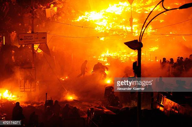 Fires burn as antigovernment protesters clash with police on February 18 2014 in Kiev Ukraine Violent clashes have once again erupted in the city of...