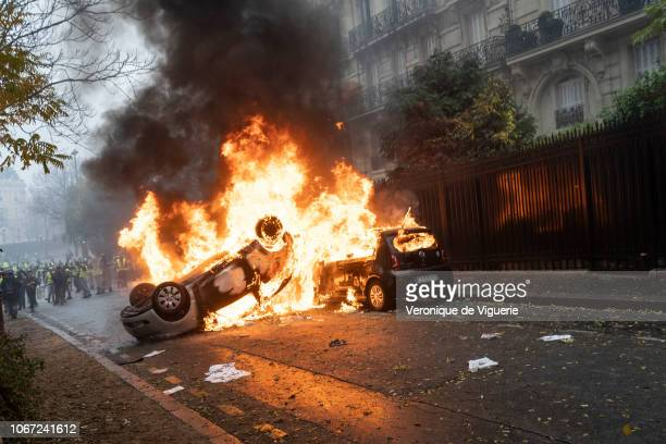 Fires burn as protesters clash with riot police during a 'Yellow Vest' demonstration near the Arc de Triomphe on December 1 2018 in Paris France The...