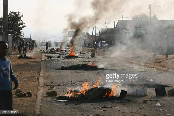 Fires burn as riots break out over inadequate housing and poor public services July 21 2009 in Balfour Mpumalanga South Africa Police used rubber...
