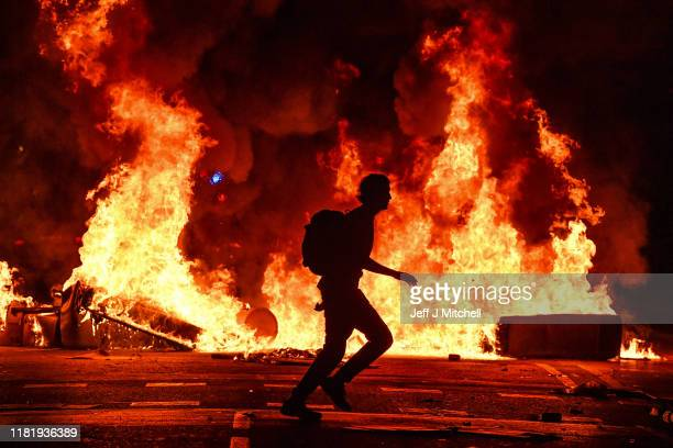 Fires burn following an evening of rioting as a general strike is called after a week of protests over the jail sentences given to separatist...