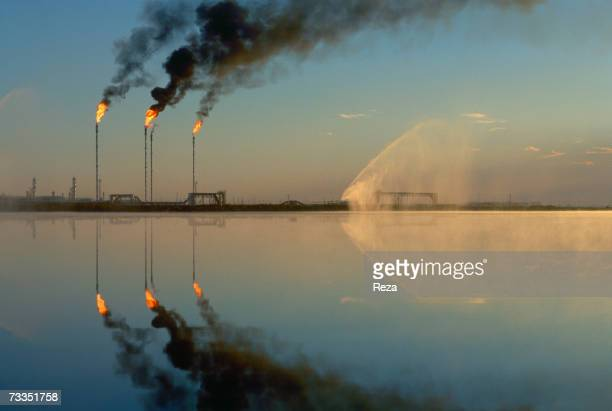 Fires burn from the tops of tall stacks at the Tengiz oil field on the northeastern shore of the Caspian Sea on September 1997 in Tengiz Kazakhstan...