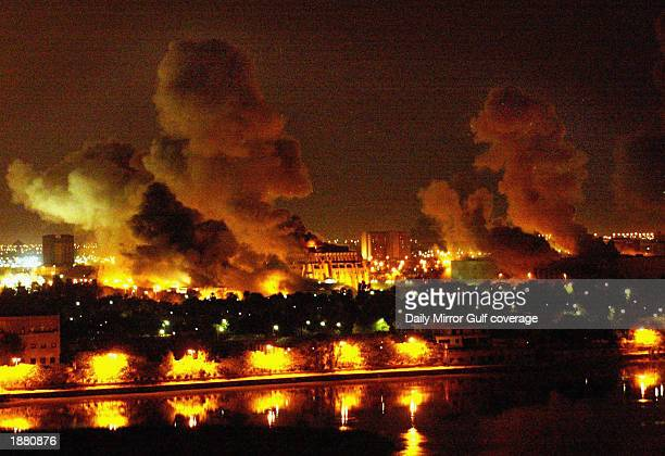 Fires burn in and around Saddam Hussein's Council of Ministers during the first wave of attacks in the 'shock and awe' phase of 'Operation Iraqi...