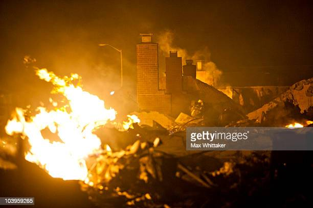 Fires continue to burn around chimneys during a massive fire in a residential neighborhood September 9 2010 in a San Bruno California A massive...