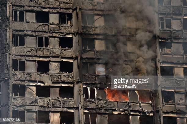 Fires continue to rage at the 24 storey residential Grenfell Tower block in Latimer Road West London on June 14 2017 in London England The Mayor of...