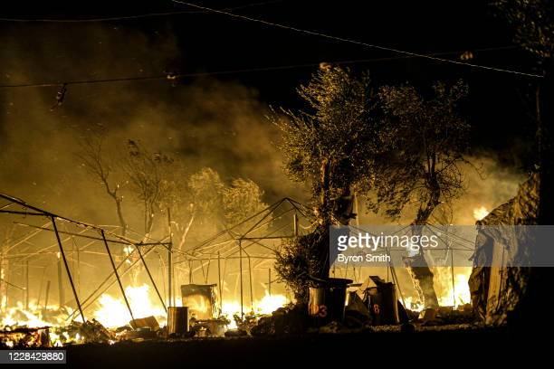 Fires continue to rage for a second night in the Moria migrant camp on September 9, 2020 in Lesbos, Greece. A massive fire ravaged the Moria migrant...