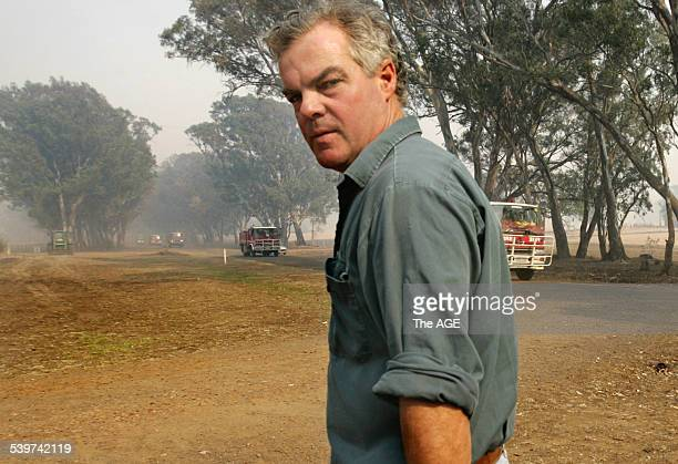 Fires Farmer Andrew Beveridge at smokefilled Mirranatwa as a strike team passes by to a fire which may come down the Victoria Valley in the Grampians...