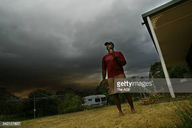Fires in East Gippsland. A worried Ian Baxter looks out over his property and the fire threatening from the Little Dick Ranges near Bruthen. 7...