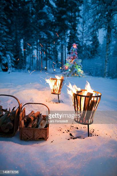 fires in pits in snowy field - country christmas stock pictures, royalty-free photos & images