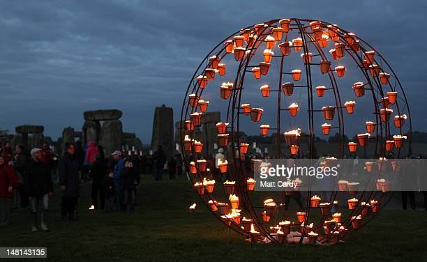 Fires light the ancient megalithic monument of Stonehenge during the Fire Garden as part of the Salisbury International Arts Festival on July 10 2012...
