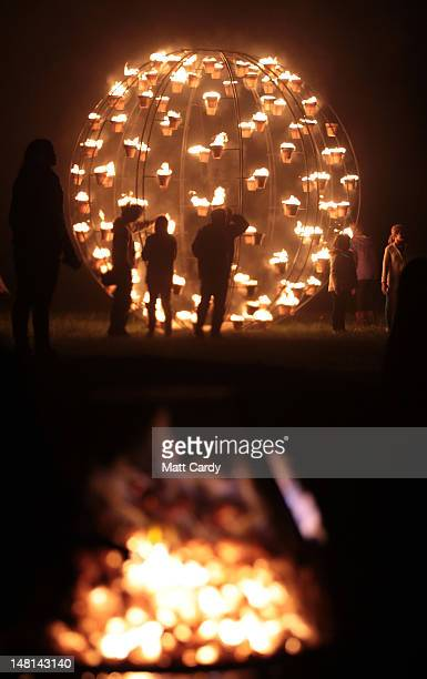 Fires light the ground surrounding the ancient megalithic monument of Stonehenge during the Fire Garden as part of the Salisbury International Arts...