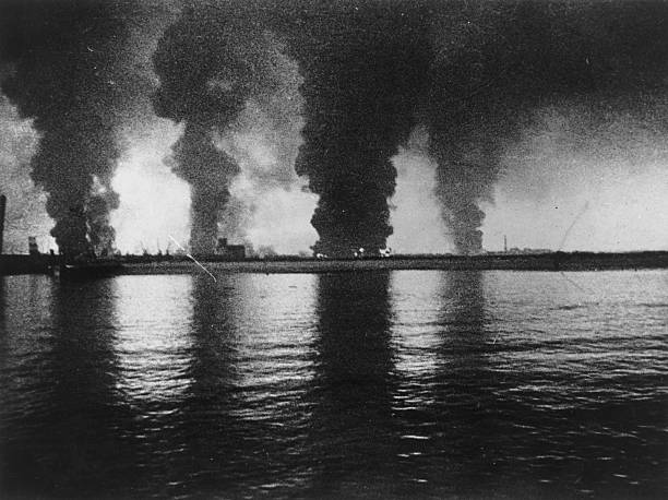 Fires raging at Dunkirk, seen from a destroyer, during...