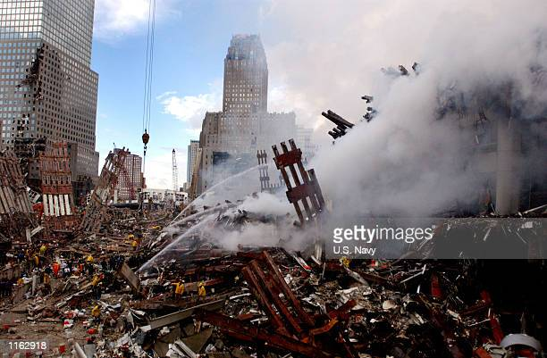Fires still burn amidst the rubble of the World Trade Center September 13, 2001 days after the September 11, 2001 terrorist attack.