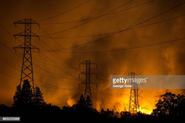 A firestorm that began in Napa Valley's Calistoga roars down the hills from Fountaingrove and into the Coffey Park and Orchard Mobile Home Park...