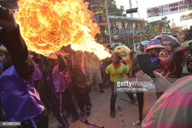 A fireswallower performs during the Carnival of Jacmel 95 km from PortauPrince February 19 2017 The city on southern coast of Haiti renowned for its...