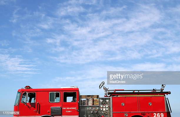 firetruck against a blue sky - firetruck stock photos and pictures