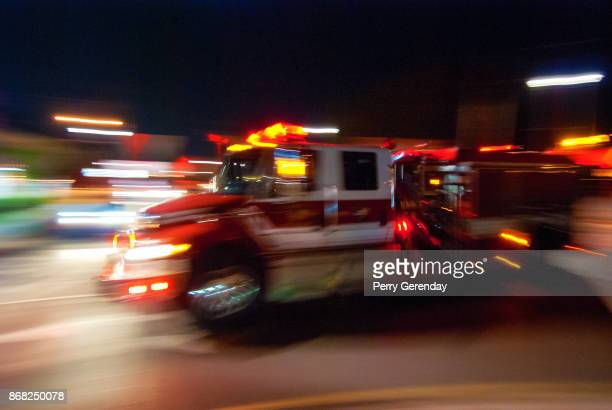 firetruck in motion - firetruck stock photos and pictures