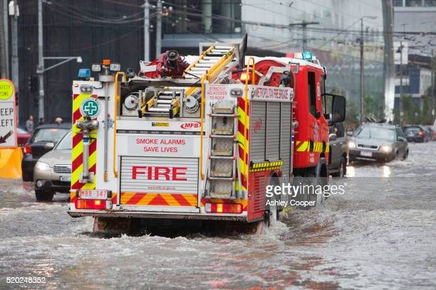 Firetruck on flooded streets after a tropical storm in Melbourne, Australia