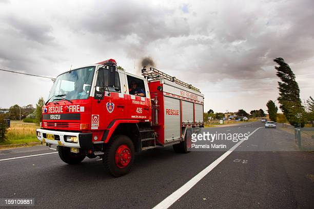 A firetruck rushes towards the Kybeyan Valley New South Wales on January 8 2013 in Nimmitabel Australia NSW was declared a total fire ban with the...