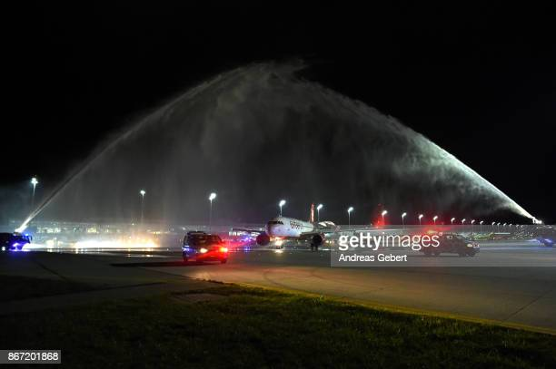 Firetrucks spray arcs of water in a ceremonial farewell over Air Berlin flight AB 6210 departing for Berlin at Munich International Airport on...