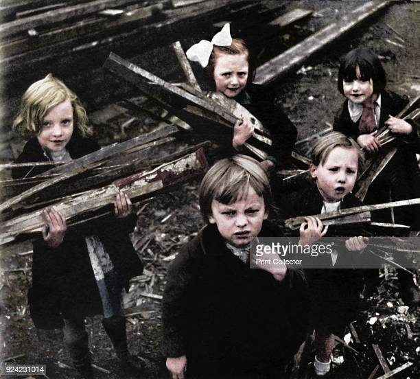 'Firewood' 1941 Wartime children collect firewood amongst the rubble From Air of Glory by Cecil Beaton [His Majesty's Stationery Office London 1941]...