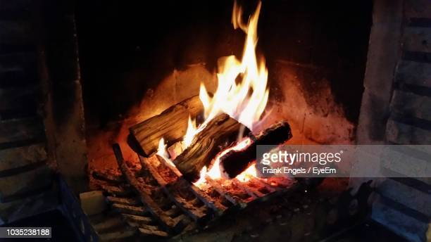firewood burning at fireplace during night - frank engels stock pictures, royalty-free photos & images