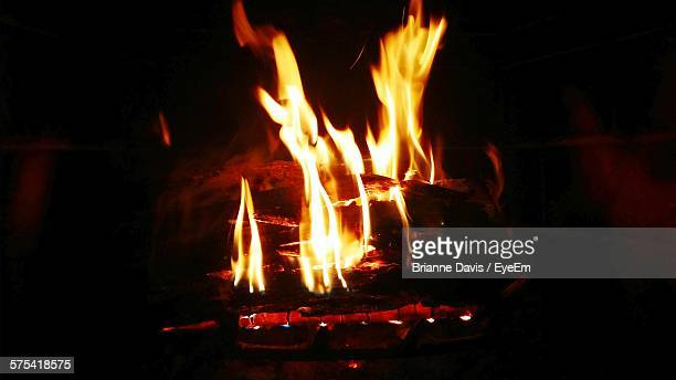 firewood burning in fire pit - brianne stock pictures, royalty-free photos & images