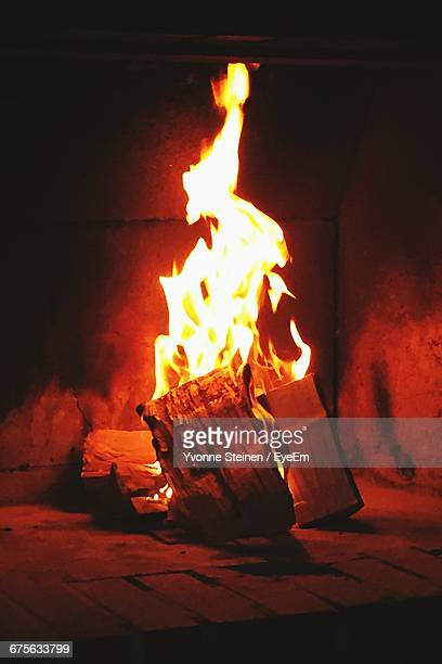 Firewood Burning In Fireplace At Home