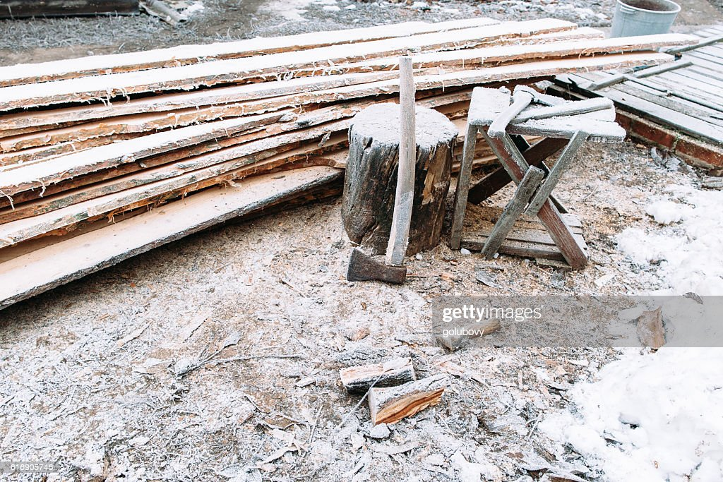 Firewood chopping workplace frosted by snow : Stock Photo