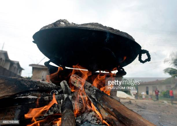 Firewood generates heat to cook foodat Ibafo Ogun State on August 22 2015 Firewood is largely used for cooking in subSaharan Africa AFP PHOTO/PIUS...