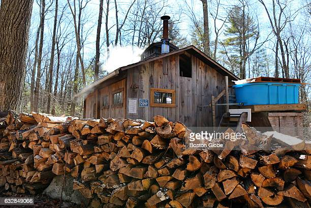Firewood is piled outside of the sugar shack where maple sugaring takes place at the Moose Hill Wildlife Sanctuary in Sharon MA on Feb 26 2016