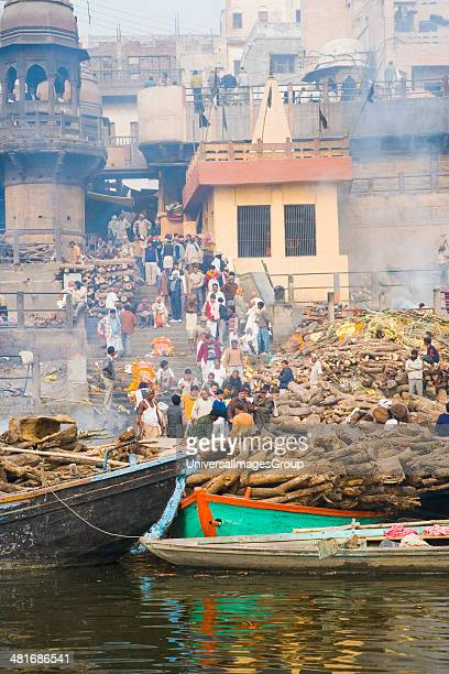 Firewood on the boats with cremation of dead bodies at a ghat Manikarnika Ghat Ganges River Varanasi Uttar Pradesh India