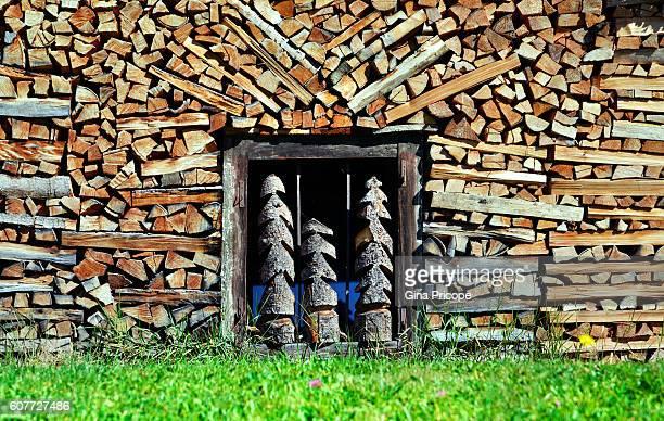 Firewood piled around a basement window in Veneto, Italy.