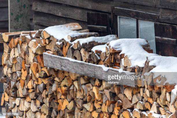 Firewood stacked in front of a log cabin - Königssee, Bavaria, Germany
