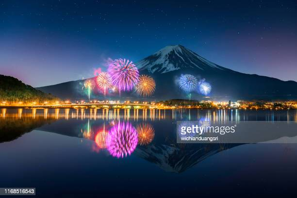 firework at lake kawaguchiko with mt. fuji as background - mt. fuji stock pictures, royalty-free photos & images