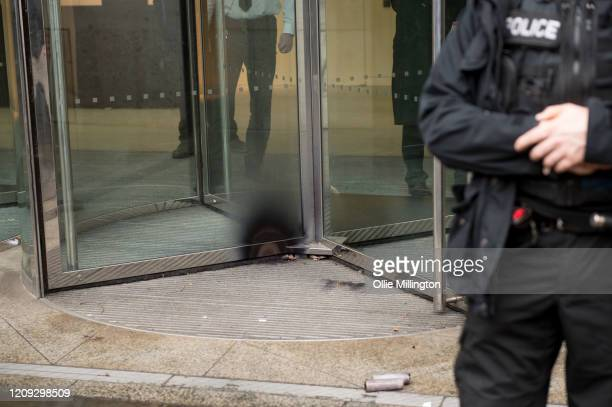 Firework damage seen on a door as protestors from the Green Anti-Capitalist Front clashed with Police after the group entered the London Stock...