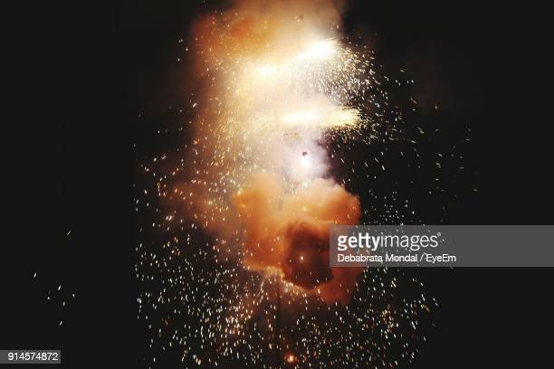 firework display against sky at night - sparks stock pictures, royalty-free photos & images