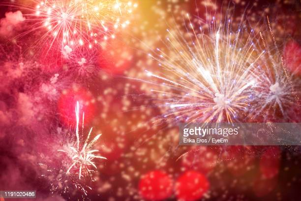 firework display at night - fireworks stock pictures, royalty-free photos & images